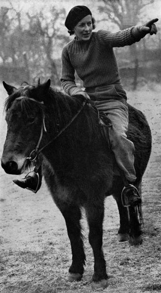 Frances Donaldson riding her daughter's pony on her farm in Warwickshire in WW2.