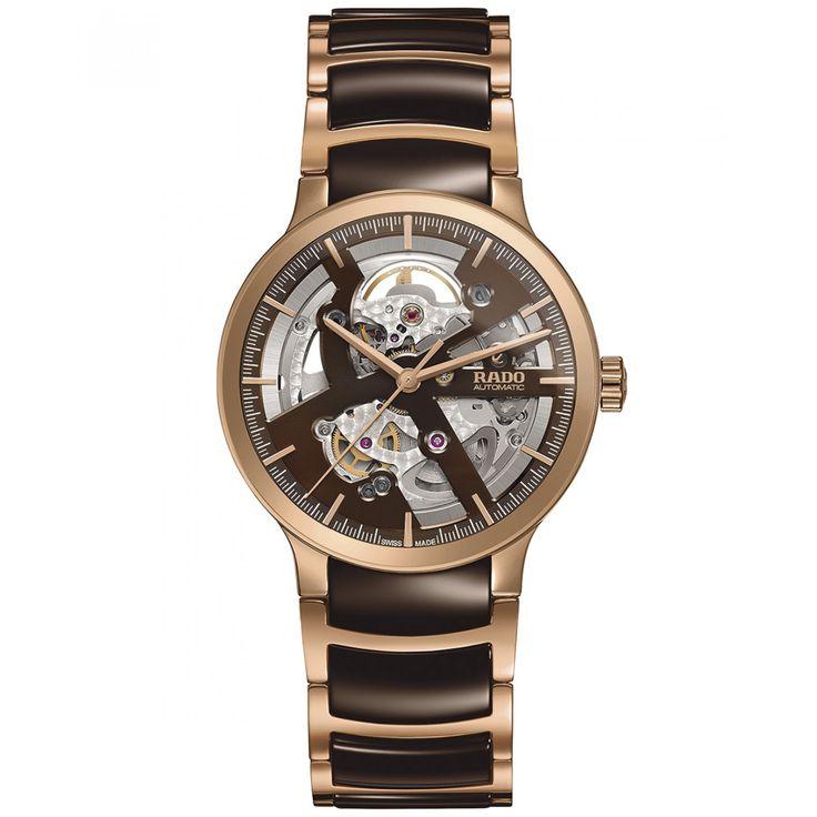 Reloj Rado con caja y bisel en acero extensible tipo brazalete en cerámica color chocolate carátula con diseño Open Heart manecillas indicadores y nombre de la marca a contraste.