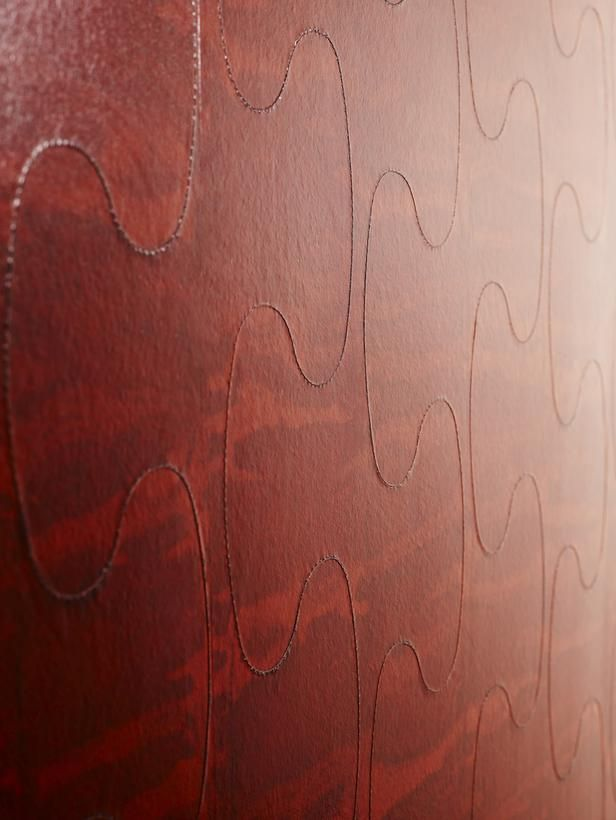 The Latest in Wall Covering Trends: The Stitched Puzzle looks like expensive leather, but it's really just hand-dyed paper and polyester thread. Although it comes in several hues, you can also customize a color to match your decor. From DIYnetwork.com