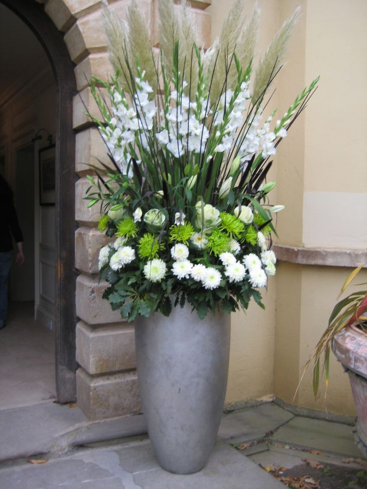 Large Vertical Arrangement With White Gladiola Steel