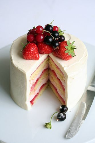 Berry cake. Layers of sponge cake, raspberry mousse, raspberry couli and sliced strawberries.   Im going to find the recipes!!!! Yummy
