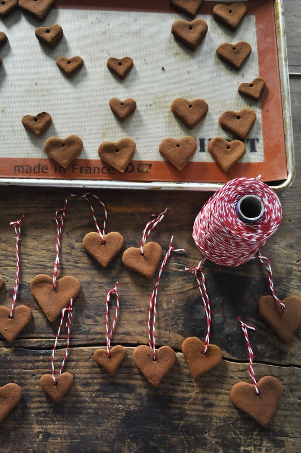 1 cup of applesauce  1 1/2 cups cinnamon (look for a big containers at $1 stores, bulk stores or amazon.)  2 Tablespoons cloves optional (grind with a spice grinder)  heart cookie cutters in different sizes  string for hanging