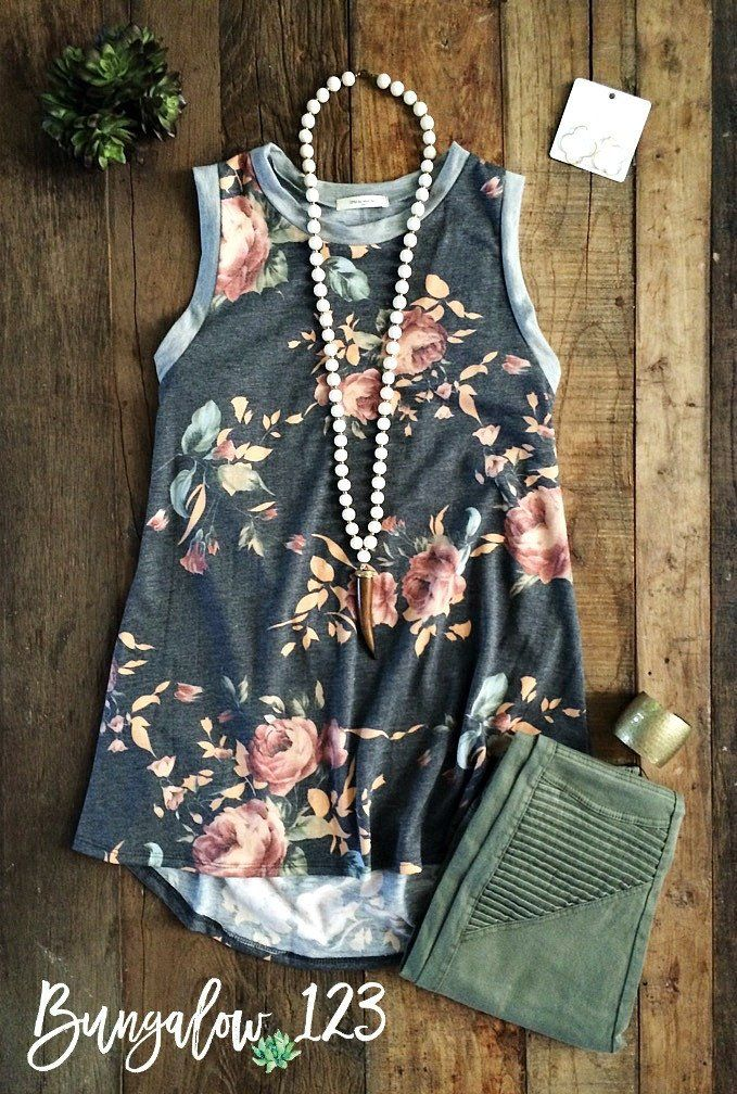Soft floral print top in Charcoal Gray with solid banding around neck and sleeve lines. Pullover style with easy fit. If in-between sizes, we recommend ordering the larger of the two. 65% Poly 35% Ray