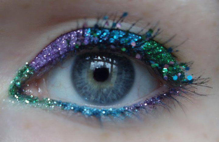 Purple, blue, and green eye makeup