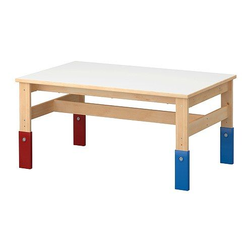 This adjustable-height children's table from IKEA is one of the best purchases we've ever made.  My four kids use it multiple times every day!