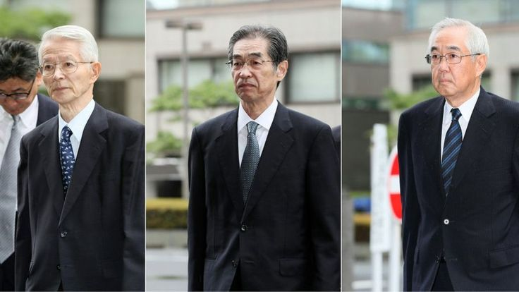 Three ex-power company executives plead not guilty at the first criminal trial linked to the disaster.