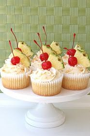 Glorious Treats: Pina Colada Cupcakes {Recipe}. Great hit at work potluck! Added some straws for the piña colada decor