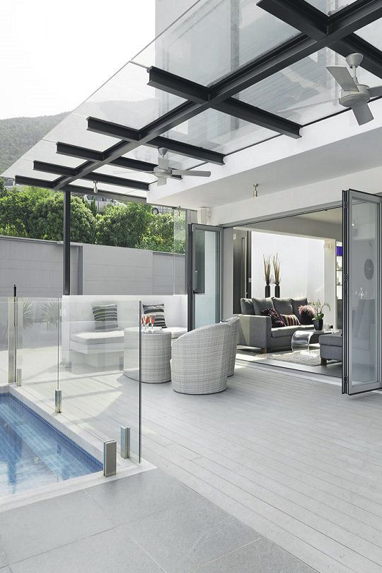 Architectural Designs Awesome! Pool off deck has glass enclosure. Note: Glass canopy with fan above!: