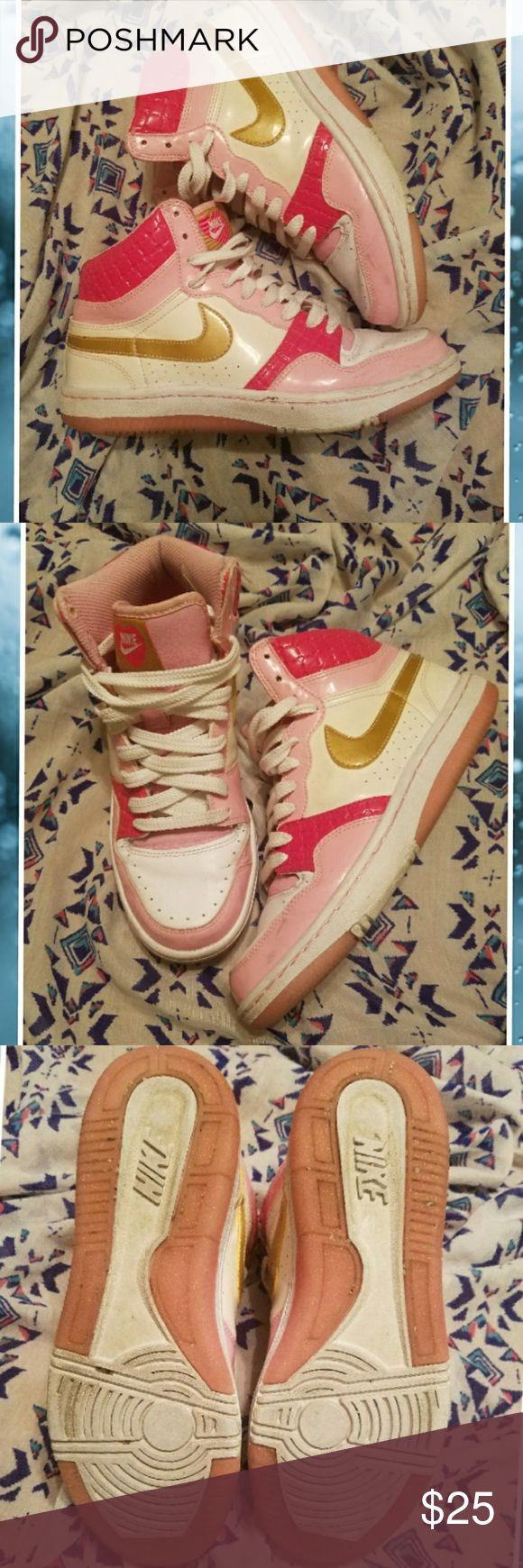 Nike hi tops pink white gold 8 Nike hi tops in good overall shape. Shows some signs of wear. Nike Shoes Athletic Shoes