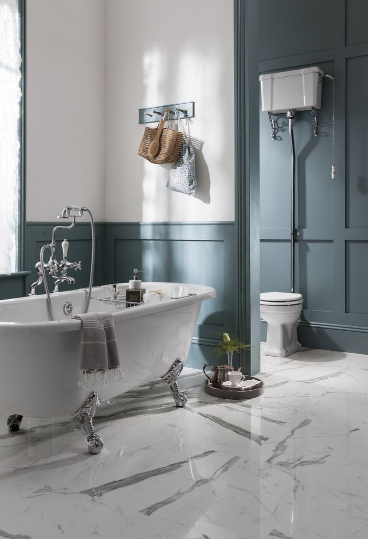 Panelled walls, stand alone bath and traditional cistern