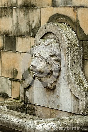 Lion head on the fountain. Old Town in Cracow. Poland