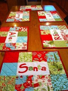 Personalized Placemats-by Chris Warnick-Six festive, personalized placemats about 13″x18″ each after washing. You can use this tutorial to make any kind of placemat with personalization in the center or even replace the personalization block with two additional charm squares. I tried to include lots of pictures so that even a beginner could tackle this project. This is an easy and quick project perfect for a holiday gift!