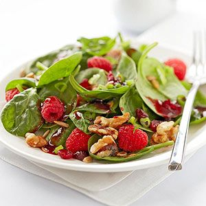 With its bright red dressing, this fresh spinach, fruit, and nut salad is nice to serve during the holidays. Make it a side dish or a light main dish.