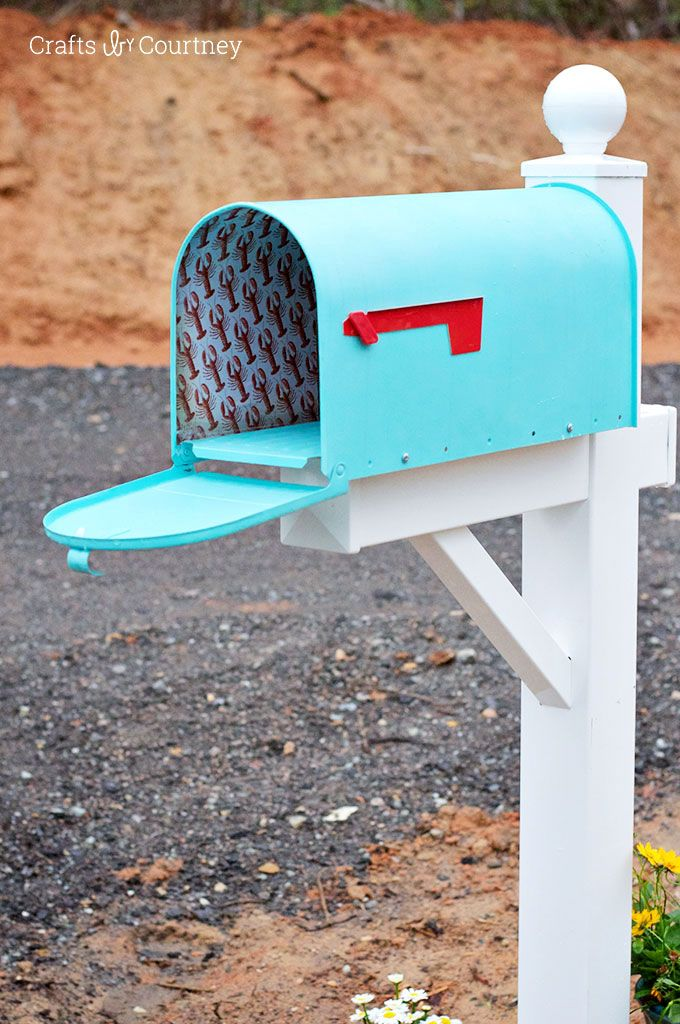 Add a fun pattern (like the lobster one seen here) to the inside of your mailbox with scrapbook paper and outdoor Mod Podge.