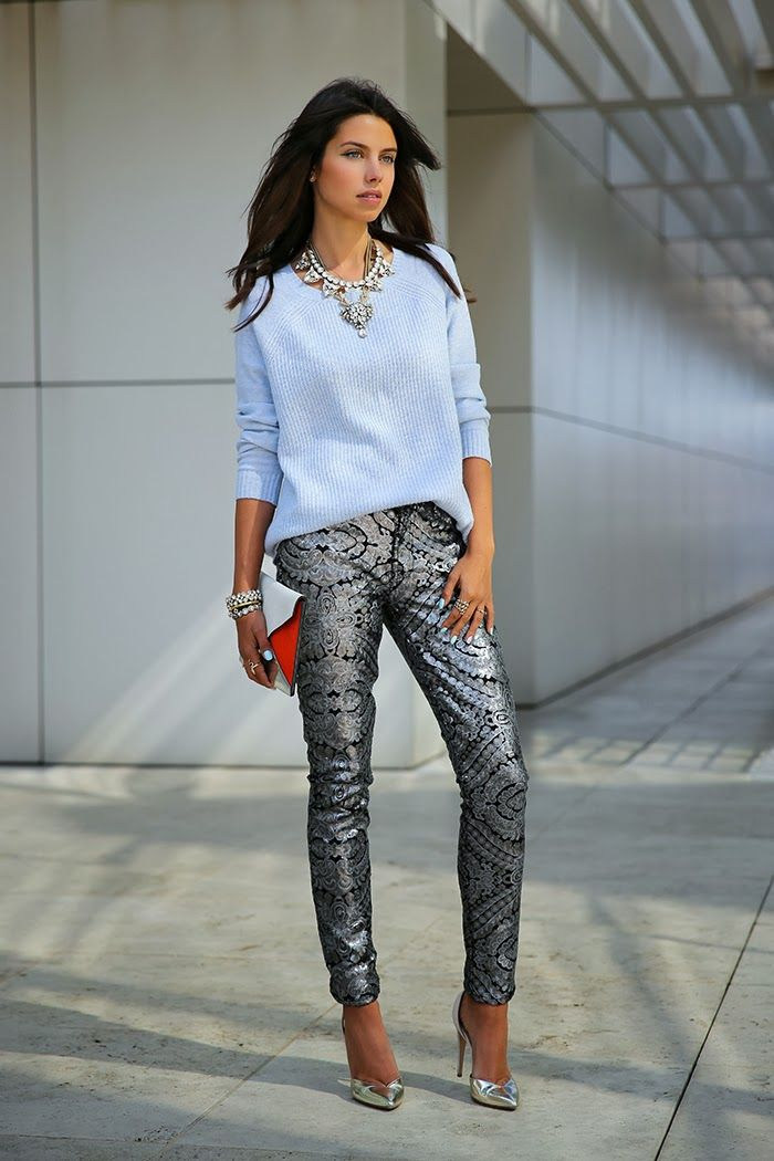 necklace with pastel blue sweater and metallic pants