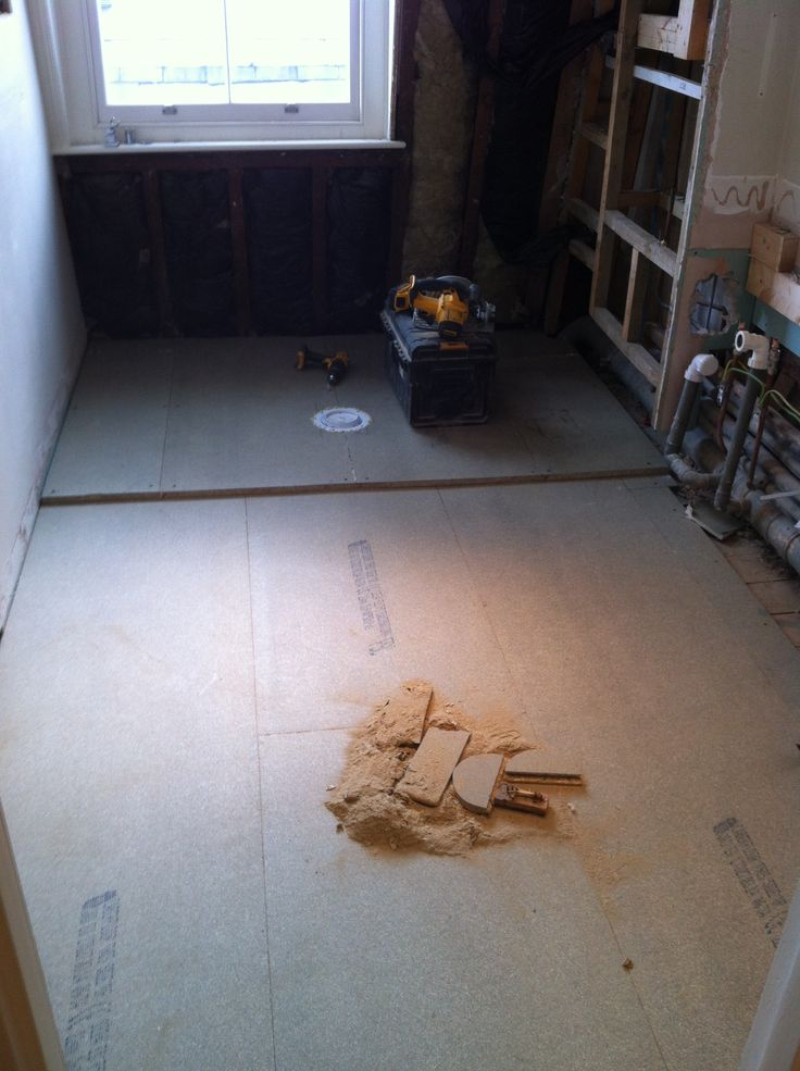 New 22mm MR chipboard floor laid. Gully trap installed to rear slightly raised area.