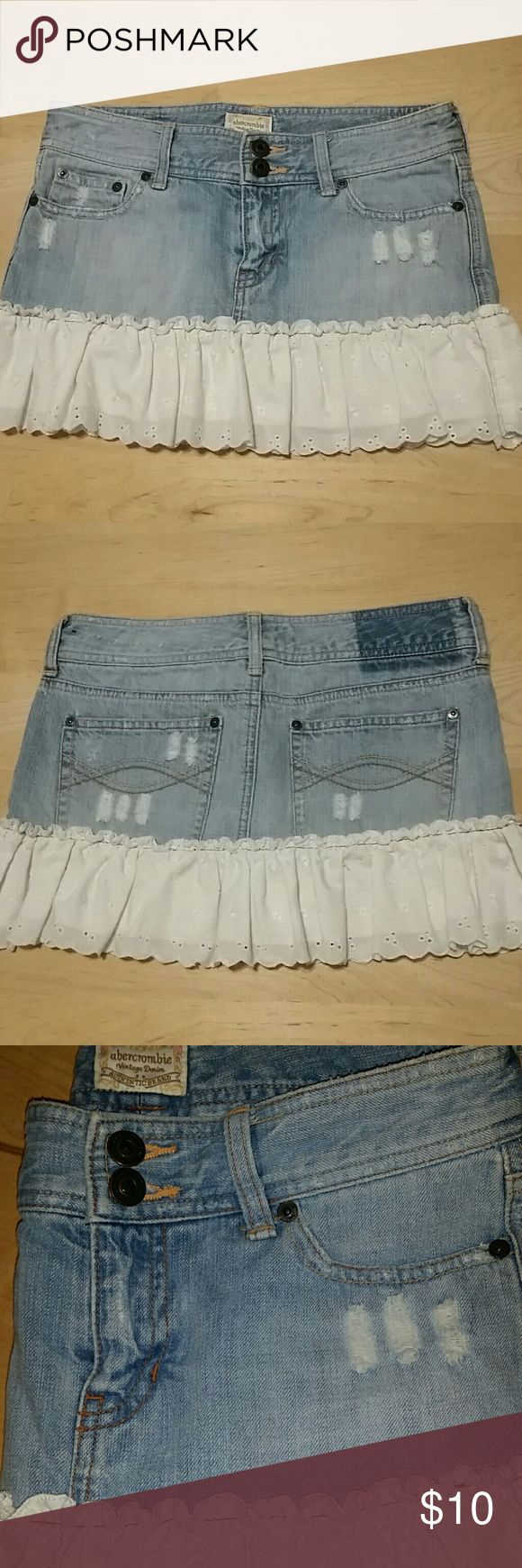 Abercrombie Girls Denim Skirt 14 Size: 14  Abercrombie Vintage Denim, skirt has intentionally been distressed by A&F, not me. It features a white eyelet trim around the bottom.   Any questions please feel free to ask!  Offers are welcome through the offer button :) Abercombie Kids Bottoms Skirts