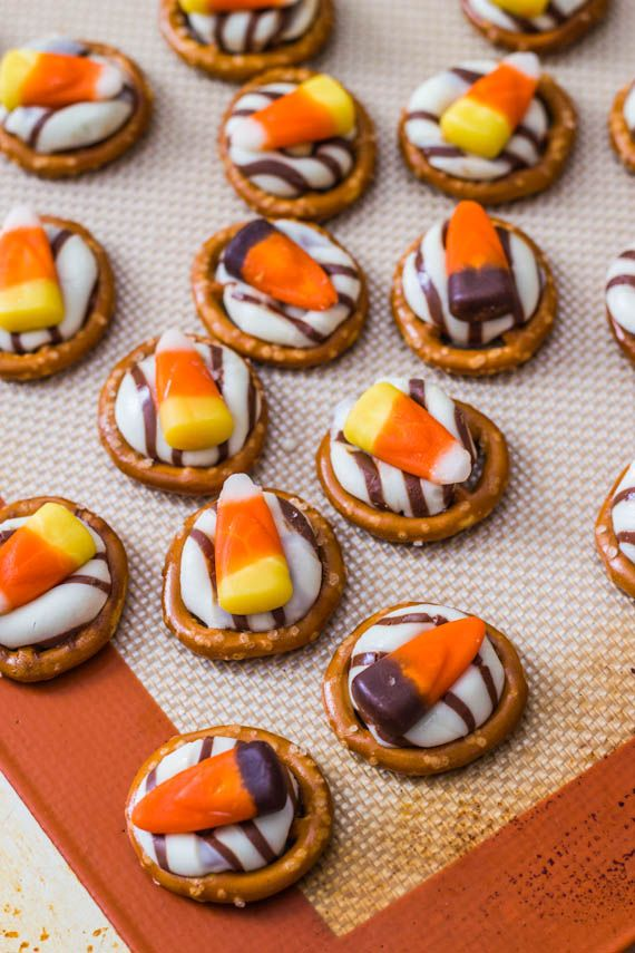 I DIE over anything candy corn! Candy Corn Pretzel Hugs. Can't wait to make these with GF pretzels!