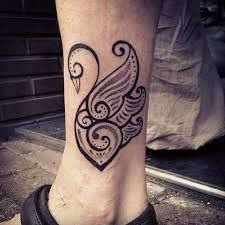 http://thelyricwriter.hubpages.com/hub/White-And-Black-Swan-Tattoos-And-History-Swan-Tattoo-Meanings