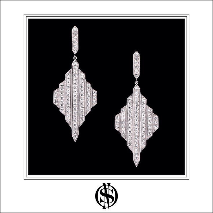 Silver and zircons earrings / Aros en plata y circones