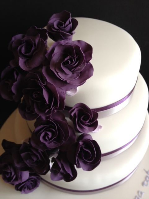 Google Image Result for http://3.bp.blogspot.com/-Q_QVpqxnS7Y/T8zPxdxeH4I/AAAAAAAAAns/0zC4-hHmrmU/s1600/purple-roses-cascading-wedding-cake-wedding-cakes-in-tamworth.JPG