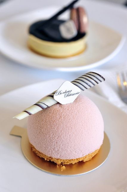 Light Peach Sakura, one of the signature pieces at Bonheur. A domed light peach mousse with a sakura infused chocolat blanc centre, resting on a piece of butter pound, with a pâte sablée disc as a base.