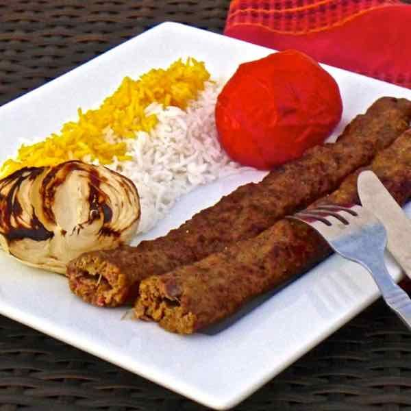 """Chelo kabab literally means """"white rice with kebab"""". This ground beef version of kebab with onions and saffron is called koobideh."""