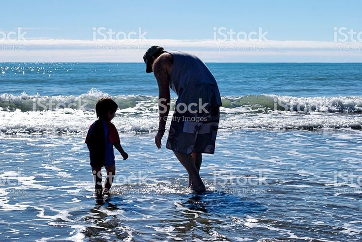 Father and Son Paddling in Sea royalty-free stock photo