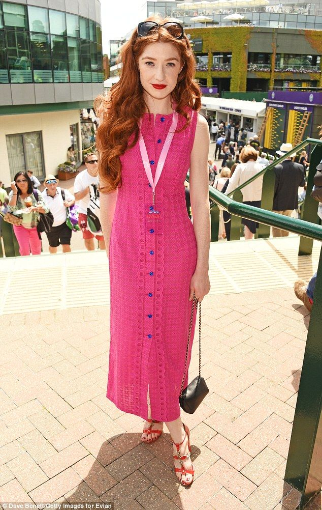 Pretty in pink: Over by the Evian Live Young suite, Nicola Roberts looked vibrant in a bright pink button-down summer dress Jun 2016