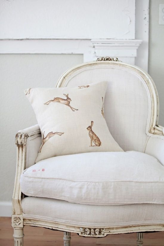 white chair with hares on the pillow