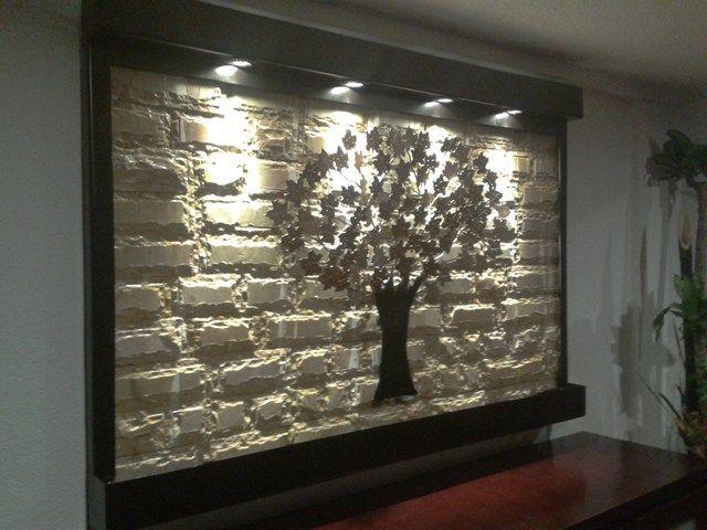 fuente de pared o muro llorn en acero y mrmol amarillo con diseo de rbol de