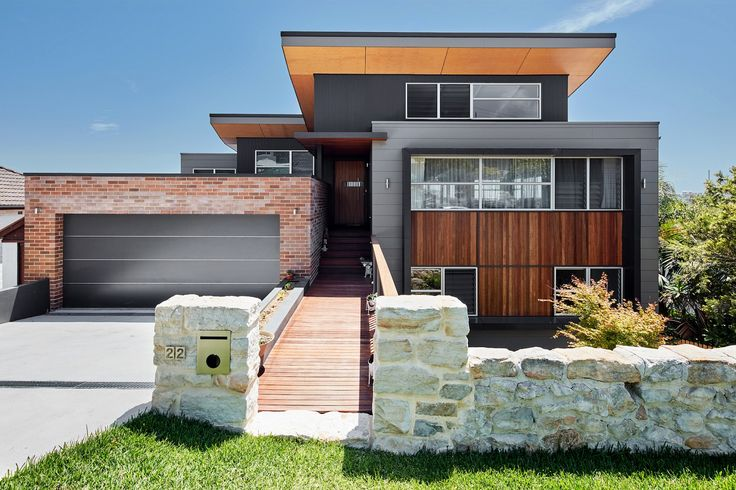This modern two-storey home in Queenscliff used a varied palette of neutral colours and materials to create a bespoke family home.