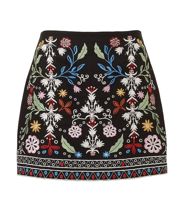 More is more with the Embroidered Skirt. This black woven mini skirt features all over contrast embroidered details, side zip closure and falls to above the knee.