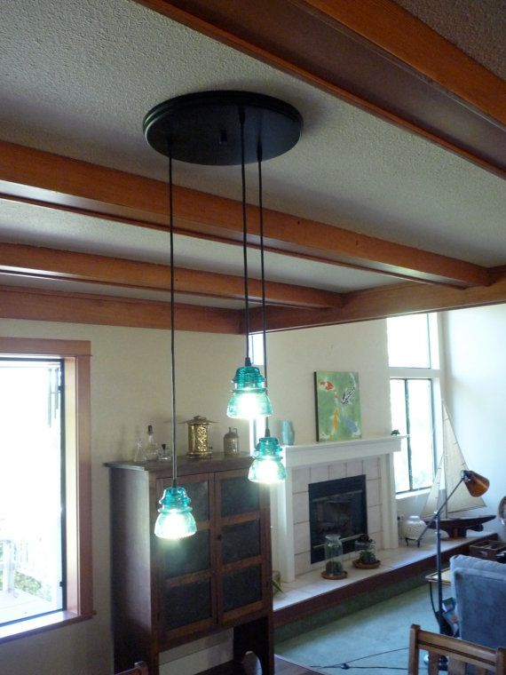 55 curated bottle and mason jar diy ideas by for Diy glass insulator pendant light