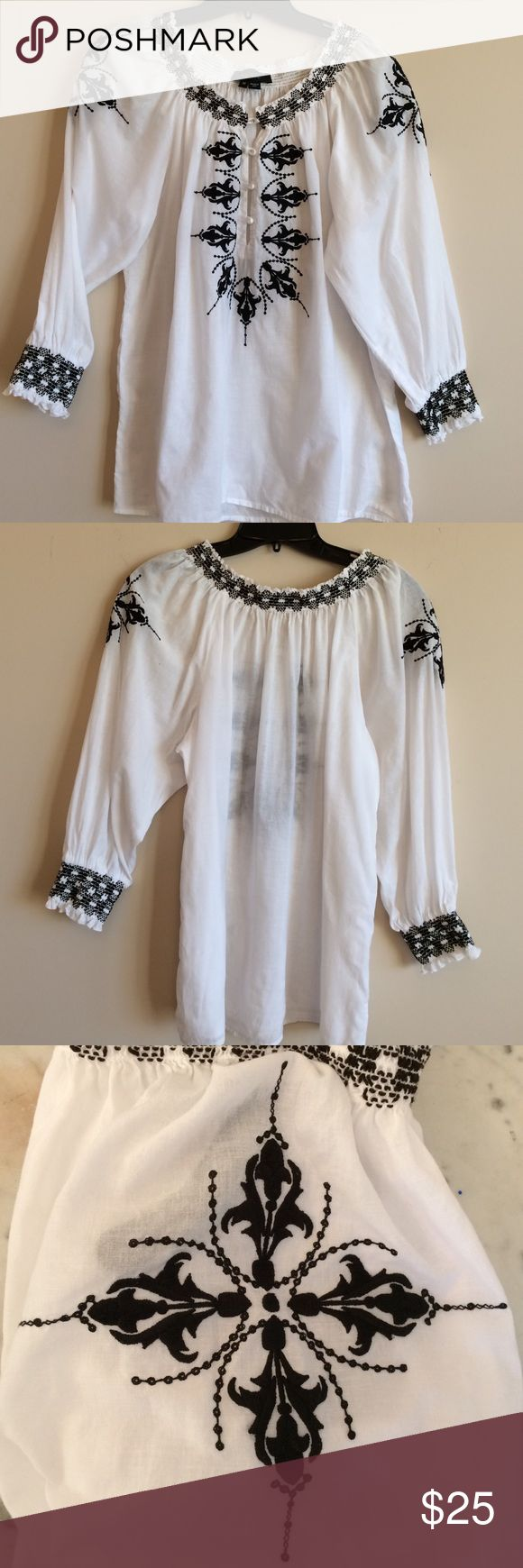 Karen Kane Black and White Embroidered Peasant Top Gorgeous Karen Kane black and white embroidered peasant top. Embroidery on shoulders also. Excellent condition. Karen Kane Tops Tees - Long Sleeve