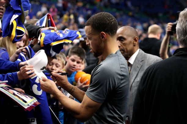 Stephen Curry of the Golden State Warriors signs autographs before the game against the Minnesota Timberwolves on March 10 2017 at Target Center in...