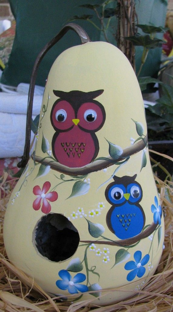 I just love owls so,I decided to paint a very bright and cheerful owl birdhouse. I base painted this gourd in a beautiful yellow.Then I