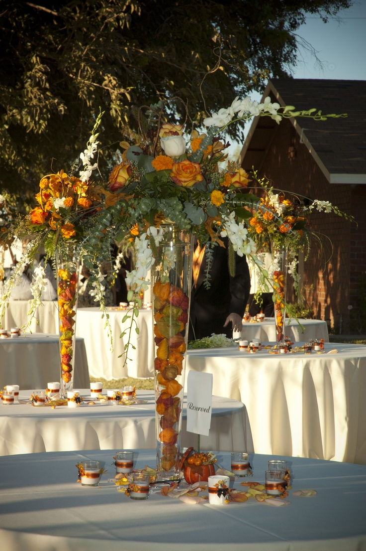 Table Centerpieces  Tall tapered glass vases filled with