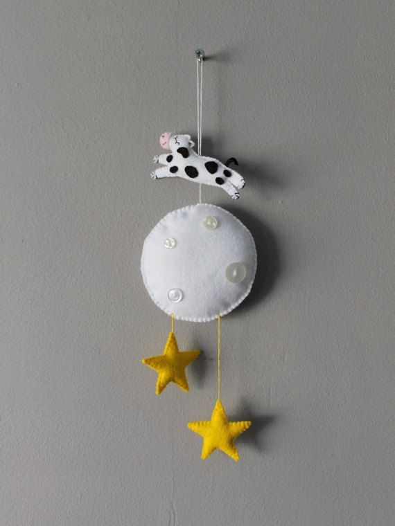 Hey Diddle diddle, The Cat and the Fiddle, The Cow Jumped over the Moon...  I love the hey diddle diddle poem and used this as inspiration for this cute felt mobile.  This item would look adorable in a childs bedroom (out of reach of course!).  The cow, moon and stars are made from felt and lightly stuffed with hygienic toy stuffing and hand stitched from a hand drawn pattern.  The sleepy cows patches are made from black felt all hand sewn by me and comes with silky ribbon tail and a cute…