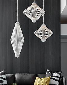 Ces luminaires avec des formes différentes conviennent à un séjour-salon contemporain.  La blancheur des luminaires contraste avec les matériaux muraux.  Ajoute de la légèreté. www.boutiqueluminaire.ca