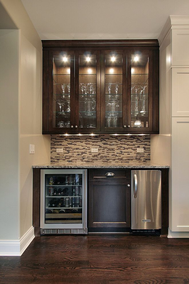 small wet bar with mini fridge sink overhead glass cabinets and