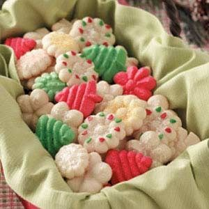 Holiday Spritz Cookies Recipe from Taste of Home -- These crisp buttery cookies make a welcome gift or sweet party treat.