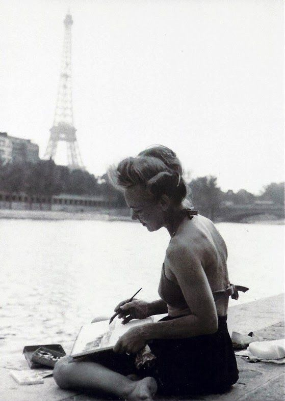 Young woman painter on the Seine banks, 1949.