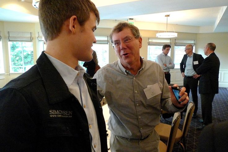 Carlsen with Apple's chairman Arthur Levinson.