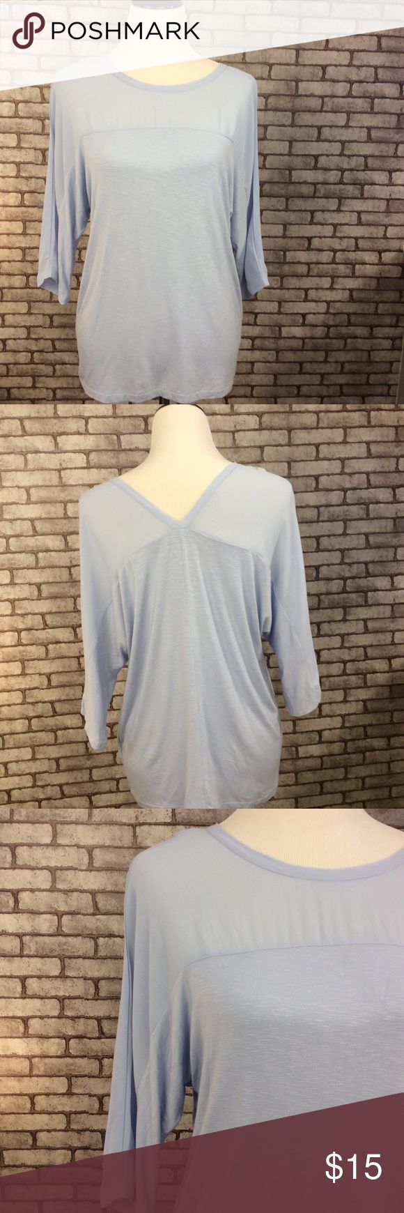 Anthropologie Dolan top These is a beautiful top, gently used but great condition. There are a few pin size spots as pictured. Has a v neck back, self 100% viscose contrast 95% rayon 5% spandex, dry clean. No rips or pilling. ⭐️ no trading or modeling ⭐️ Anthropologie Tops Blouses