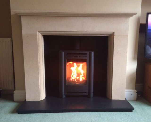 This is a local installation by the Hagley Stoves team. The Elite fireplaces Dorsington 2 surround was fitted with a Riven slate hearth and chamber. The fabulous Contura i4FS Classic stove works perfectly as the fireplace was custom made 100mm taller to suit both the stove and the room height.