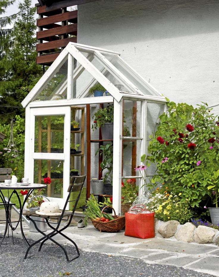 small greenhouse - I wonder if the husband could build this for me? His background in construction should be useful for something :)