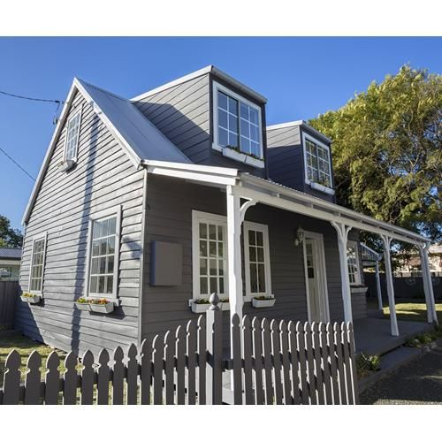Take a tour of this simple Cape Cod style weatherboard cottage renovation that netted a tidy profit for reno expert Cherie Barber and only cost $10,000.