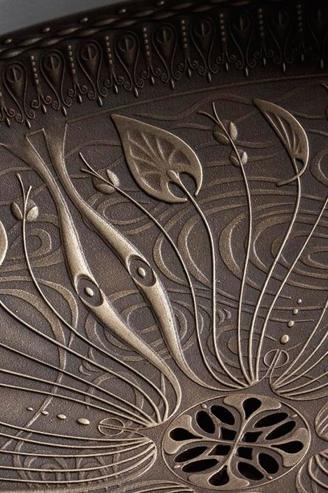 Exquisite detail in a cast bronze sink.  By Kohler