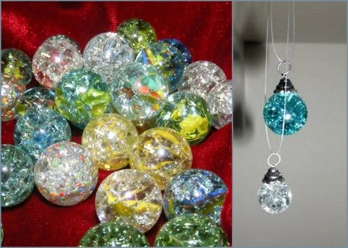 Baked marbles will crack on the inside, but not the outside! Makes for some very pretty, sparkly beads.